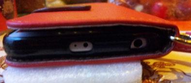 Вид на телефон в чехле сверху